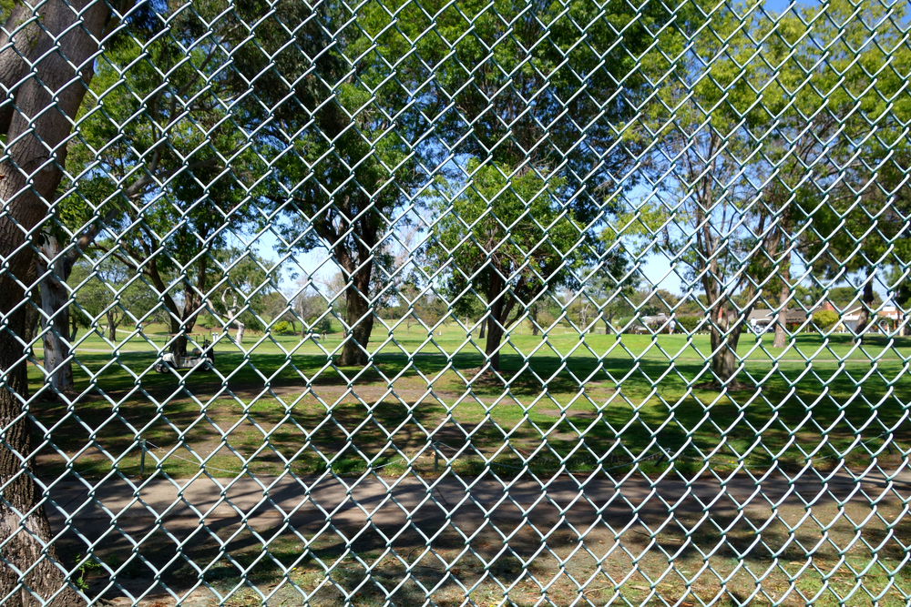 another golf course with chainwire fence