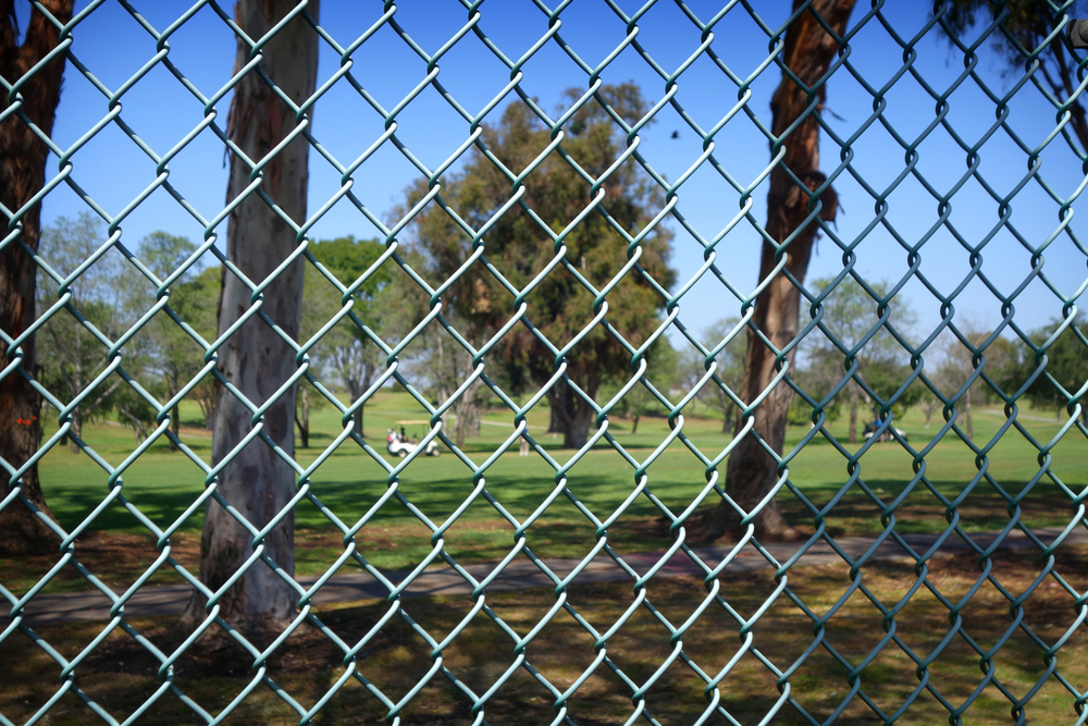 golf course with chainwire fence